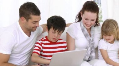 Happy Family at home looking at a computer — Stock Video