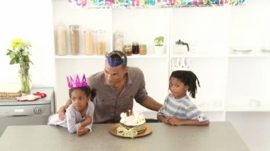 Ethnic dad and children celebrating a birthday — Stock Video