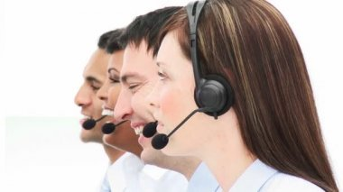 Smiling beatutiful woman working in a call center — Stock Video