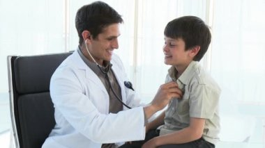 Doctor listening to a kid with a stethoscope — Stock Video
