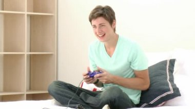 Teenager Playing a video Game — Stock Video