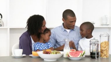 Afro-American parents and children having healthy breakfast in the kitchen — Stock Video