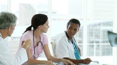 Confident medical team examining a x-ray — Stock Video