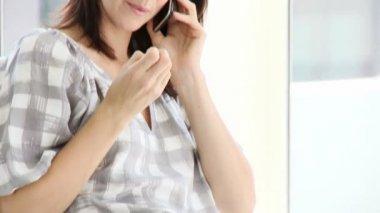 Jolly businesswoman talking on phone — Stock Video