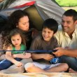 Cute family fishing in front of the tent — Stock Video #22706167