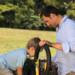 Dad and son fixing a bicycle — Vídeo de stock