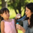 Mom and daughter blowing bubbles — Video