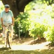 Elderly couple walking with bikes — Stock Video