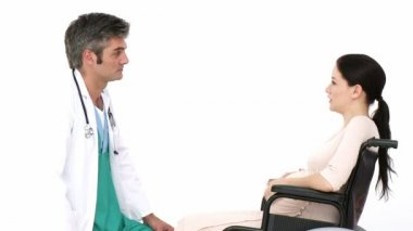 Gynecologist talking to a pregnant woman — Stockvideo