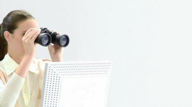 Charismatic businesswoman looking through binoculars — 图库视频影像