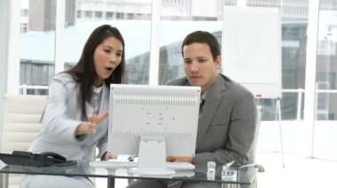 Two concentrated colleagues working at a computer — Stock Video