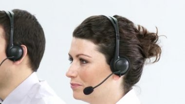 Portrait of businesspeople working hard in a call centre — Stock Video