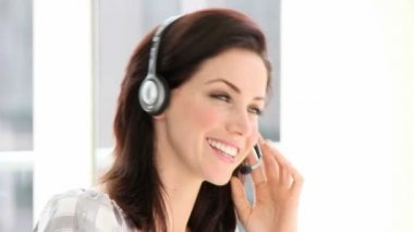 Confident businesswoman with headset on — Stock Video
