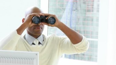 Ethnic businessman looking through binoculars — Stock Video