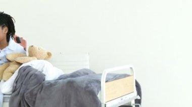 Positive doctor checking little boy's reflex — Stock Video