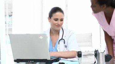 Young female doctors talking in the office — Stock Video