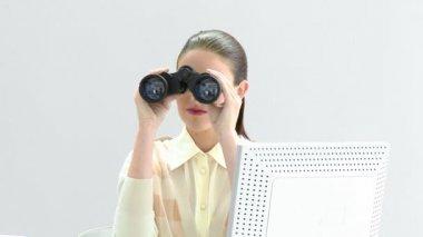 Elegant businesswoman looking through binoculars — Stock Video