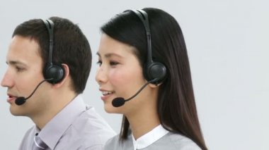 Multi-ethnic business team in a call center — 图库视频影像