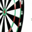 Darts grouped together in super slow motion being thrown on a dart board — Stock Video