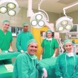 Stock Video: Several Surgeons surrounding an operation table
