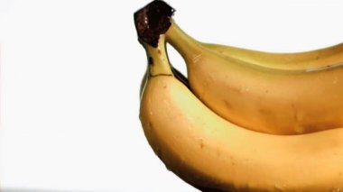 Delightful bananas in super slow motion receiving water — Stock Video