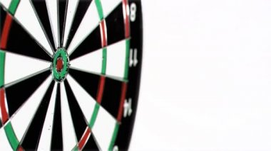 Plastic green dart in super slow motion being thrown on a dart board — Stock Video