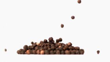Pepper corns falling in super slow motion onto a heap — Stock Video