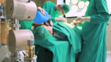Surgeons working on a patient with a resuscitation bag — Stock Video