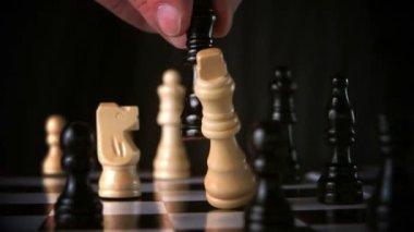 Black king taking white king — Stock Video