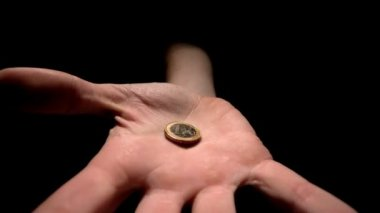 Hand grasping a euro coin — Stock Video