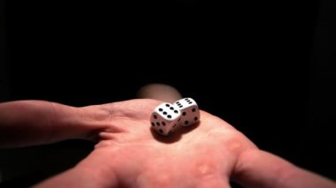 Hands grasping white dice — Stock Video