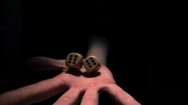 Hand grasping wooden dice — Stock Video