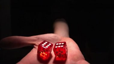 Hand grasping red dice — Stock Video