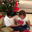 Montage of two children opening their present — Stock Video