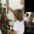 Montage of families decorating a christmas tree — Stock Video