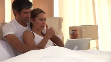 Happy couple doing shopping online — Stockvideo