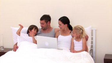 Adorable family surfing together on the web — Stock Video