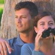 Young couple looking through binouculars — Stock Video