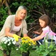 Woman doing some gardening with her daughter — Stock Video #23495679