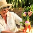 Mature woman with root vegetables — Stock Video #23495781