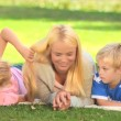 Young woman talking with her two children — Stock Video