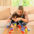 Young mother playing with her baby with building blocks — Stock Video #23495951