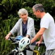 Mature couple with two bikes — Vídeo de stock