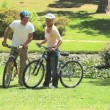 Young man and his wife cycling — Stock Video #23496207