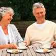 Mature couple laughing over coffee — Stock Video