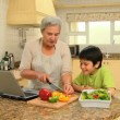 Woman giving her grandson a cookery lesson  — Stock Video