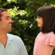 Little girl talking with her father — Stock Video