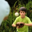 Young boy playing baseball with his father — Stock Video #23496453