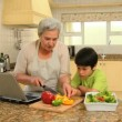 Woman showing her grandson how to cook — Stock Video