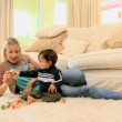 Toddler on carpet bored with building blocks — Stock Video #23496757